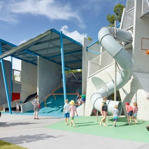 The theme of the Arena Play Structure is 'deconstruction', in that memories of the iconic Milton tennis stadium remain in symbiosis with contemporary Arena recreation. 'Deconstruction' is thus represented by large precast concrete panels of varying heights and angles; suspended concrete slabs; angled steel struts; steel mesh tunnels and barriers ...