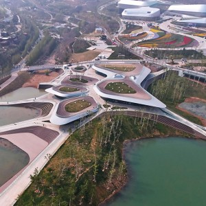 """The International Horticultural Exposition 2014 opened in Qingdao on April 25th; the two service centers, """"Heavenly Water (Tianshui)"""" and """"Earthy Pond (Dichi)"""", are named after the two extant lakes on Baiguo Mountain where the buildings are respectively located."""
