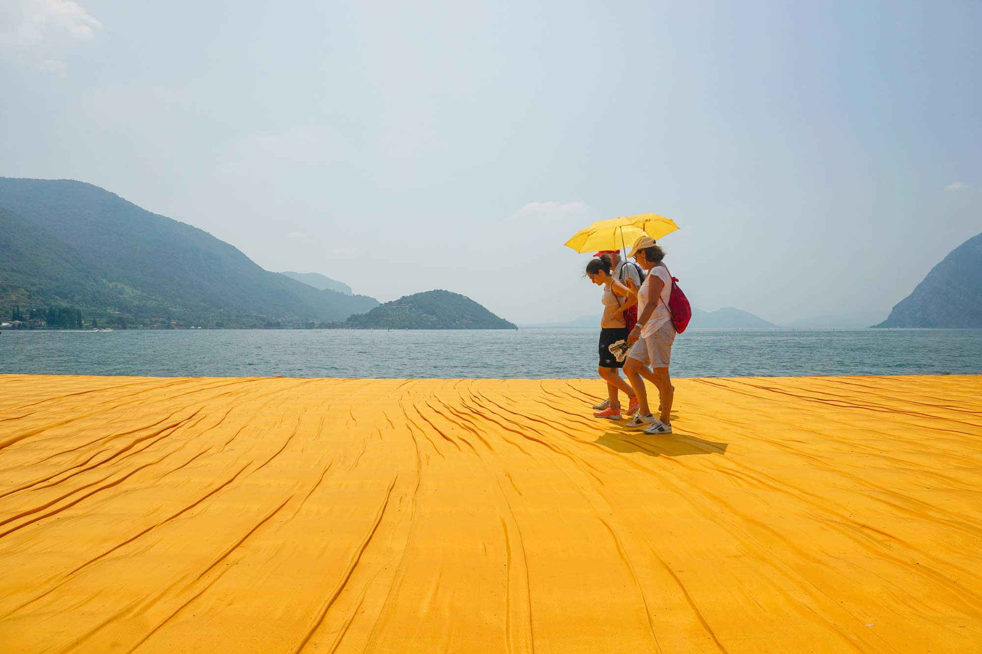 More than 40 years ago artist Christo developped the idea for the Floating Piers. After he found Lago d'Iseo in Northern Italy being the perfect place for this work, it went quick. More than 1.3 Million people had a striking haptic and visual experience walking on the orange Nylon tissue across the lake.
