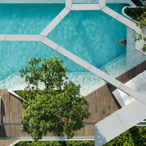 """In order to get rid of that boxy feeling space, our first move is to create a """"loosed"""" floor plan. Instead of a typical rectangular pool deck, we proposed a series of smaller terraces integrated with the swimming pool. Perpendicular lines were avoided, replaced by angled ones with round corners."""