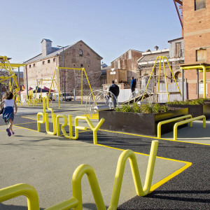 ASPECT Studios has delivered a new, vibrant and attractive public realm for the Hart's Mill Surrounds in Port Adelaide. Located adjacent to the wharf and with the backdrop of one of Adelaide's most iconic heritage listed industrial buildings, the new space includes extensive new grassed recreation areas with trees, picnic and BBQ areas as well as multifunctional spaces for events and markets.