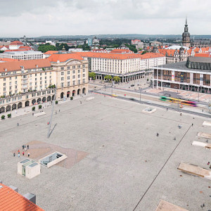"""The redesign of the Altmarkt, Dresden's oldest square, was subject to a multifaceted and complex requirement profile: the integration of a tram stop and an underground parking facility with 468 parking spaces into the area of the square, as well as the restructuring of the adjacent pedestrian areas. An urban, representative and multifunctional town plaza has emerged – an inner city """"stage"""" with a high quality of stay."""